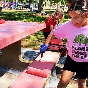 Adison Martinez and members of the Merced Fireflies Camp Fire painted two park benches.