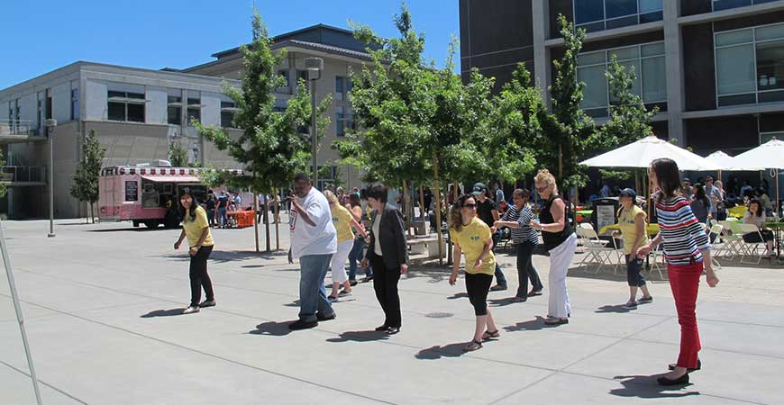 Staff members do the Electric Slide during last year's Staff Appreciation Week picnic.
