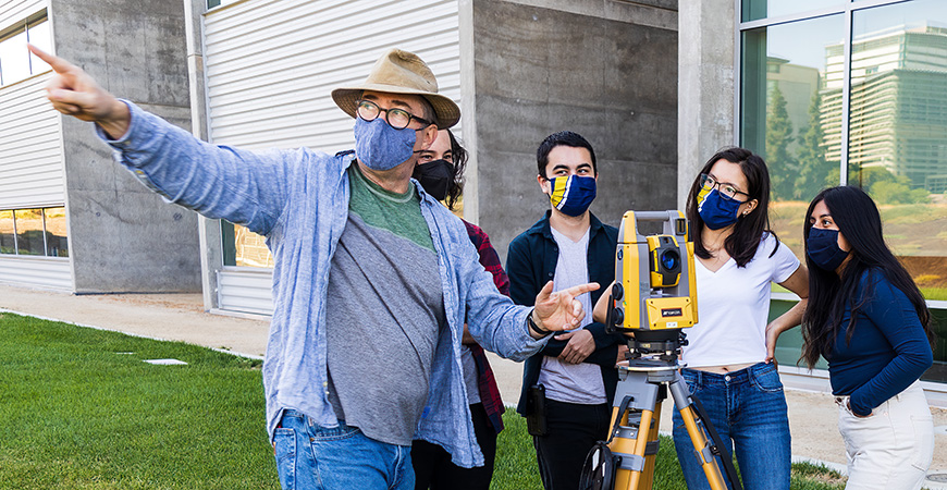 Professor Thomas Harmon shows students how to use Topcon Positioning Systems equipment on campus.