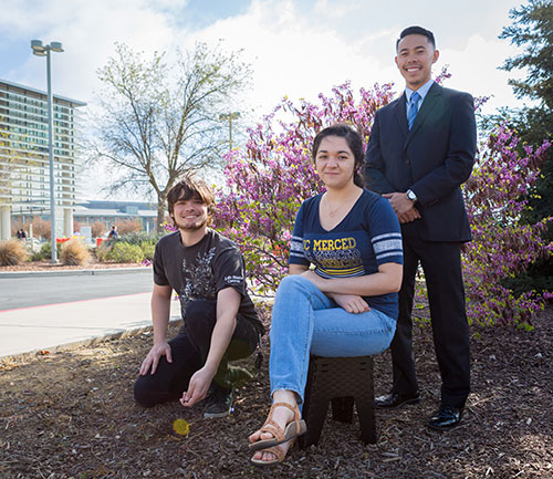 Alex Newman, left, Gabriel Morabe, standing, and Adriana Gomez are this semester's Carbon Neutrality Fellows.