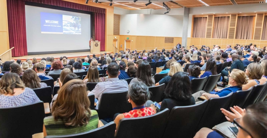 Hundreds of UC Merced staff members listen to Chancellor Dorothy Leland speak inside the Dr. Lakireddy Auditorium.
