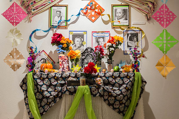 Altars are created to honor those who have passed and include photos of the deceased with items they loved.