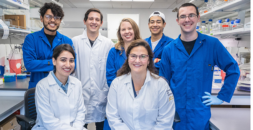 Bioengineering professor Eva de Alba in her lab with her students and postdoctoral scholar. Students in back row: Pedro Diaz-Parga, Arturo Gonzalez, Suzanne Sandin, Kevin Ramirez and Christopher Randolph. Front Row: Meenakshi Sharma and Eva de Alba.