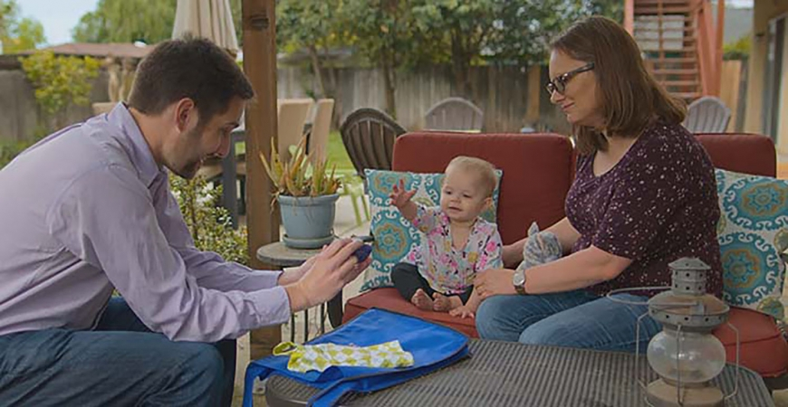 "Professor Eric Walle with Penelope and her mom, Jessica Mohatt, in a scene from the new Netflix docu-series ""Babies."""