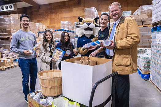 Rufus the Bobcat and students joined interim Chancellor Nathan Brostrom in delivering the food to the food bank earlier this week.