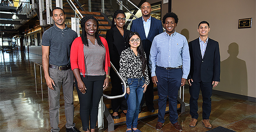 Six graduate students landed spots at Idaho National Laboratory through the National GEM Consortium (From left: Jordan Galloway, Denise Owusu, Stephanie Jones, Diana Perales, Terrence Buck (program manager), Malik Hayes, Jorge Ramirez.) Photo courtesy of Idaho National Laboratory.