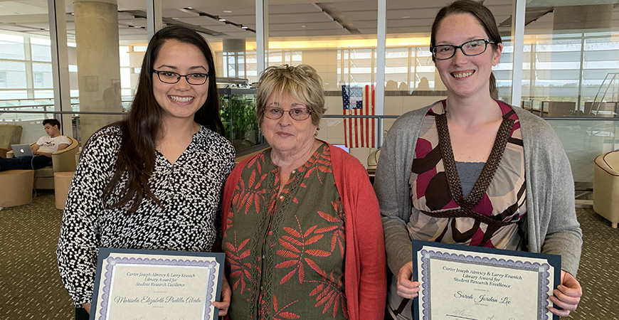 Marisela Padilla Alcala (left) and Sarah Lee were recently recognized as recipients of the Carter Joseph Abrescy and Larry Kranich Library Award for Student Research Excellence. Arlene Kranich (center) presented the awards.