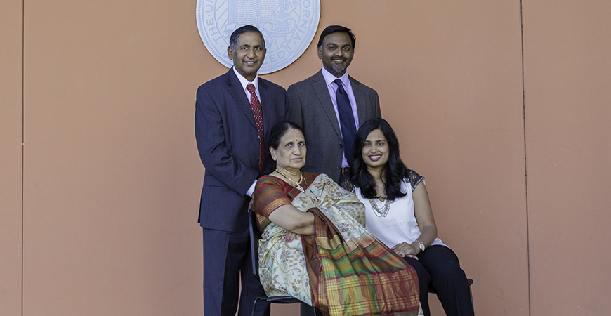 The Lakireddy family poses in front of UC Merced's Dr. Lakireddy Auditorium, one of the largest lecture halls on campus. Top: Dr. Hanimireddy Lakireddy and his son Dr. Vikram Lakireddy; Bottom: Hanimireddy's wife Vijaya and his daughter-in-law, Priya.