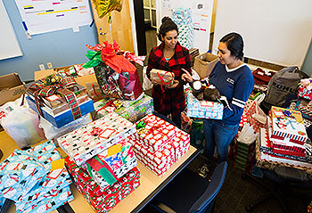 Student interns sort gifts for A Home for the Holidays, an outreach program that supports All Dads Matter.
