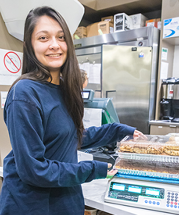 Junior Kaitlyn Aldaz has helped rescue food as the first intern for the Bobcat Eats Food Waste Awareness and Prevention Program.