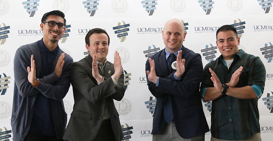UC Merced alumni showing their Bobcat pride