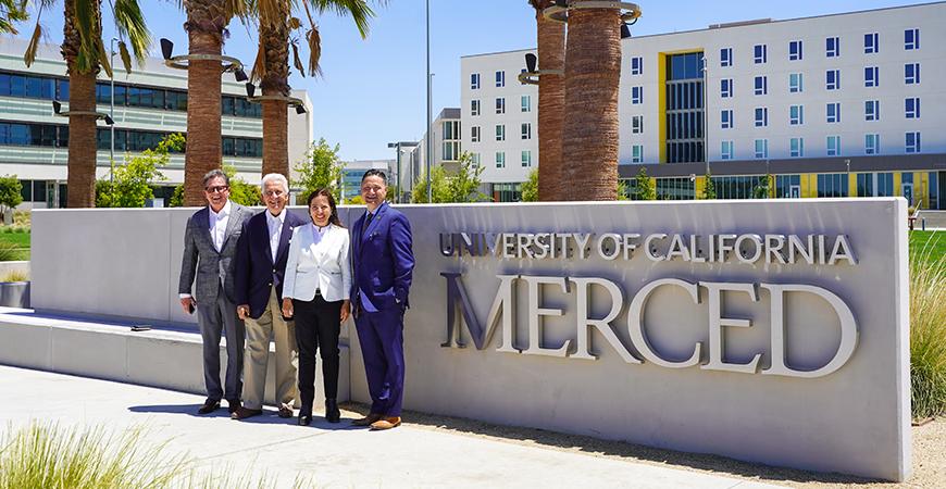 Former Assemblymember Rusty Areias, U.S. Rep. Jim Costa, Lt. Gov. Eleni Kounalakis and UC Merced Chancellor Juan Sánchez Muñoz pose for a photo on the UC Merced campus.