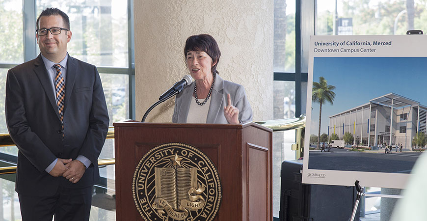 Merced Mayor Mike Murphy accompanies Chancellor Emerita Dorothy Leland at the beam signing for UC Merced's Downtown Campus Center in 2017.