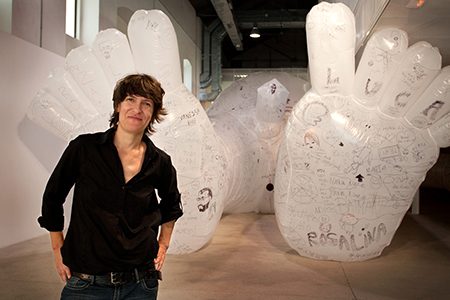 "Olga Diego in 2013 with her ""Tattooed Giant"" interactive exhibition in Spain. Photo by Juanma Lopez."