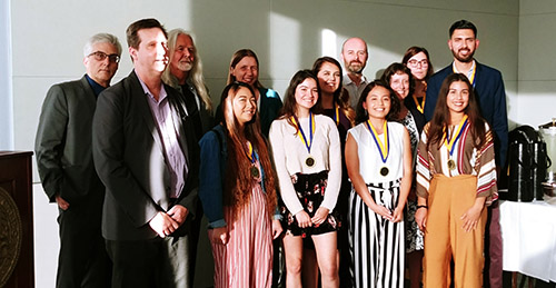 Students and faculty members pose for a photo at the Outstanding Student Awards reception for the School of Social Sciences, Humanities and Arts.