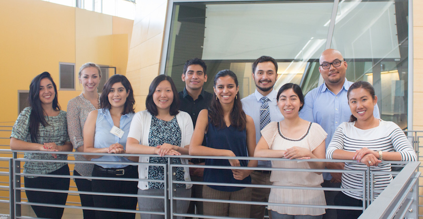 Ten students in entering SJV PRIME class pose in front of a conference room at the University of California, Merced.
