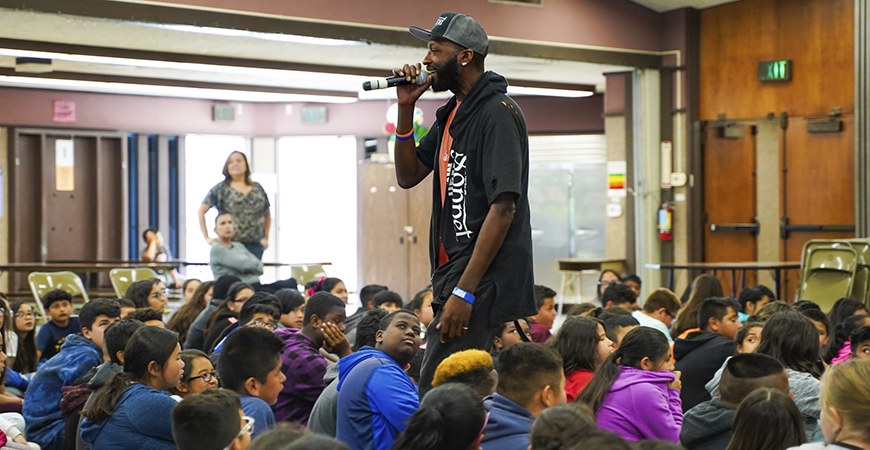Devon Glover, The Sonnet Man, speaks to students at Gracey Elementary School in Merced.