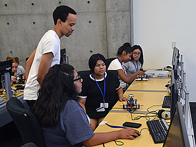 Graduate student Lorenzo Booth teaches a robotics workshop during the Upward Bound Academy this summer.