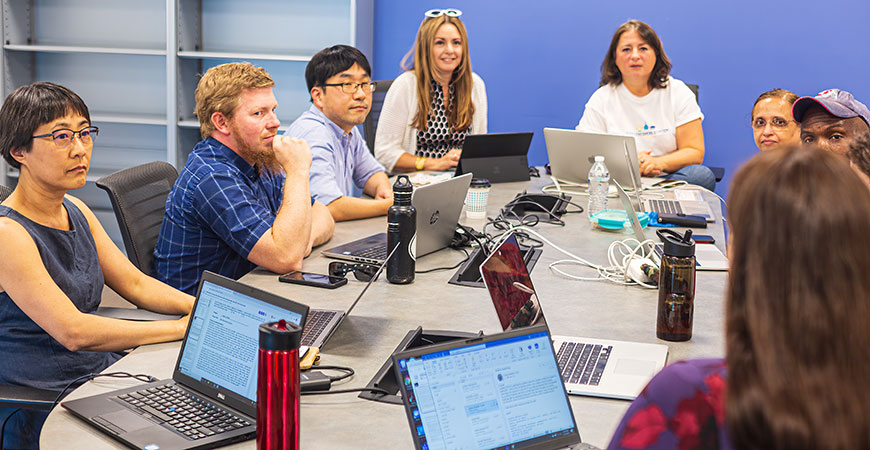 From left, UC Merced faculty Lei Yue, Keith Thompson, Changho Kim, Professor Zenaida Aguirre-Muñoz and Mayya Tokman work on planning the new calculus effort with their teammates. Photo by Jim Chiavelli