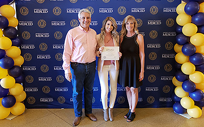 Andrade was named a Chancellor's Scholar for her exemplary work in the classroom and her parents were right by her side.