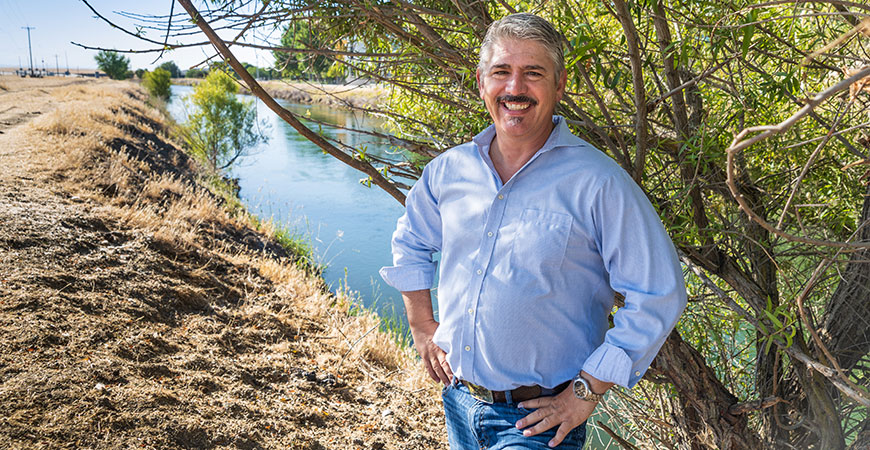 Professor Joshua Viers stands near a canal on the UC Merced campus.
