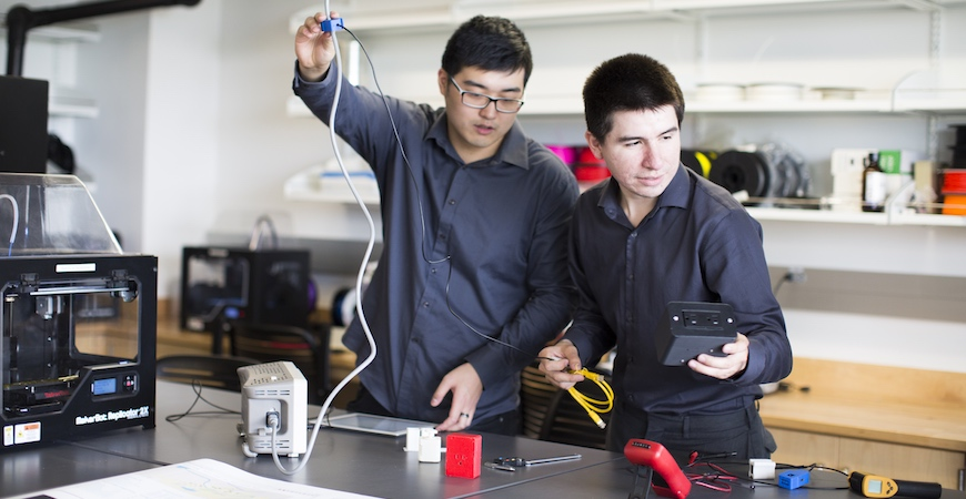 Two students in an engineering lab