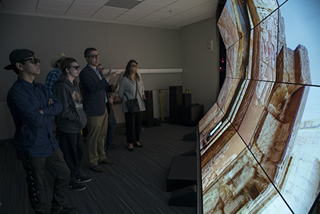 Visitors experience the WAVE, a 20-screen, 3-D visualization system.