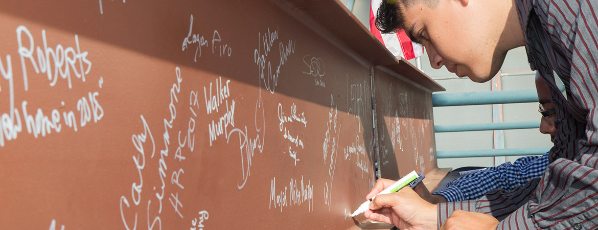 A beam-signing ceremony in the summer celebrated the Downtown Campus Center.