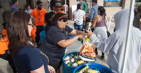 UC Merced volunteers collect food donations during the 2017 We Care Wednesday Community Food Drive at the Merced County Fair. The goal is to collect 10,000 pounds of food.