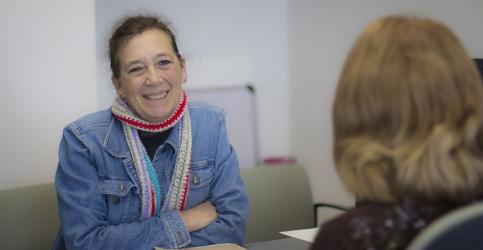 two women talking in a office
