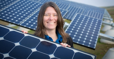 Sustainability Director Colleen McCormick and the UC Merced solar array